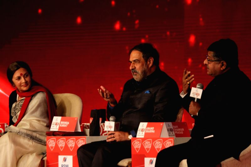 Union Telecom Minister Ravi Shankar Prasad with CPI_M leader Brinda Karat and Congress leader Anand Sharma at Agenda 15 organised by Aaj Tak in New Delhi, on Dec 11, 2015.