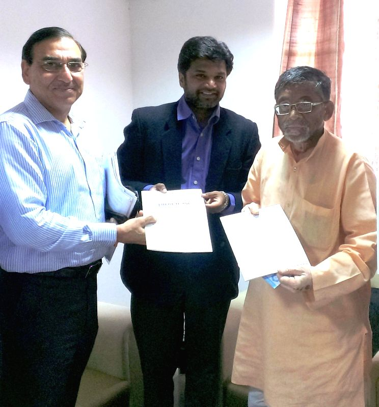 Union Textile Minister Santosh Gangwar (R) releases an ASSOCHAM Growth Agenda for Indian Textile Industry in New Delhi on July 3, 2014. Also seen ASSOCHAM Textile Council chairman Thyagu Valliappa ...