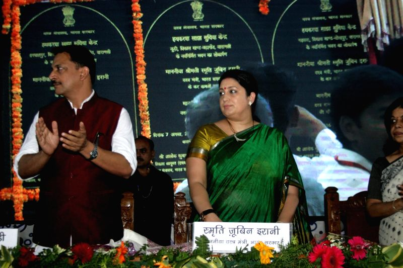 Union Textile Minister Smriti Irani and Union MoS Skill Development and Entrepreneurship Rajiv Pratap Rudy during a programme organised on 2nd National Handloom Day in Varanasi on Aug 7, ... - Smriti Irani