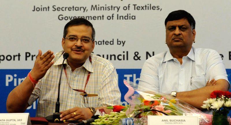 Union Textiles additional secretary Subrata Gupta (L) addresses a press conference in Kolkata on June 12, 2017. Also seen Export Promotion, Apparel Export Promotion Council Chairman Anil ... - Subrata Gupta
