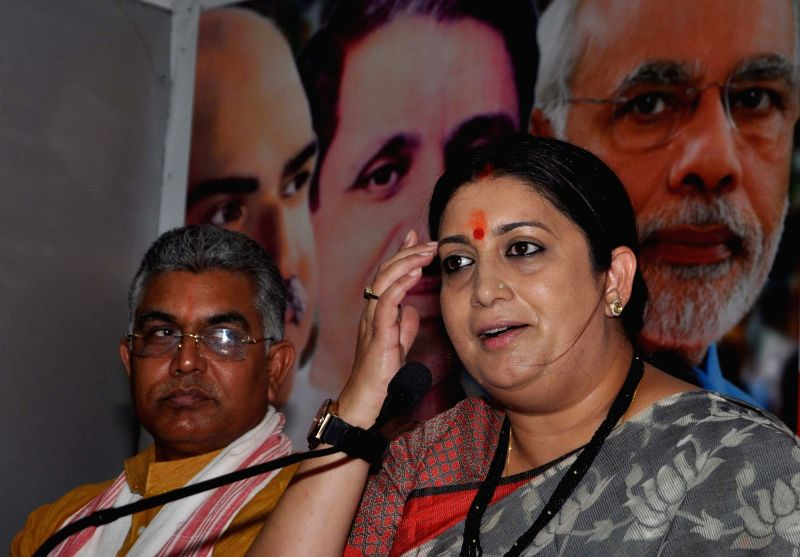Union Textiles Minister Smriti Irani and West Bengal BJP chief Dilip Ghosh during a press conference in Kolkata on April 19, 2017. - Smriti Irani and Dilip Ghosh
