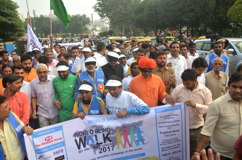 "Union Tourism Minister Alphons Kannanthanam and Delhi BJP chief Manoj Tiwari during the ""Blind Walk-2017"" programme in New Delhi on Oct 12, 2017. - Alphons Kannanthanam"