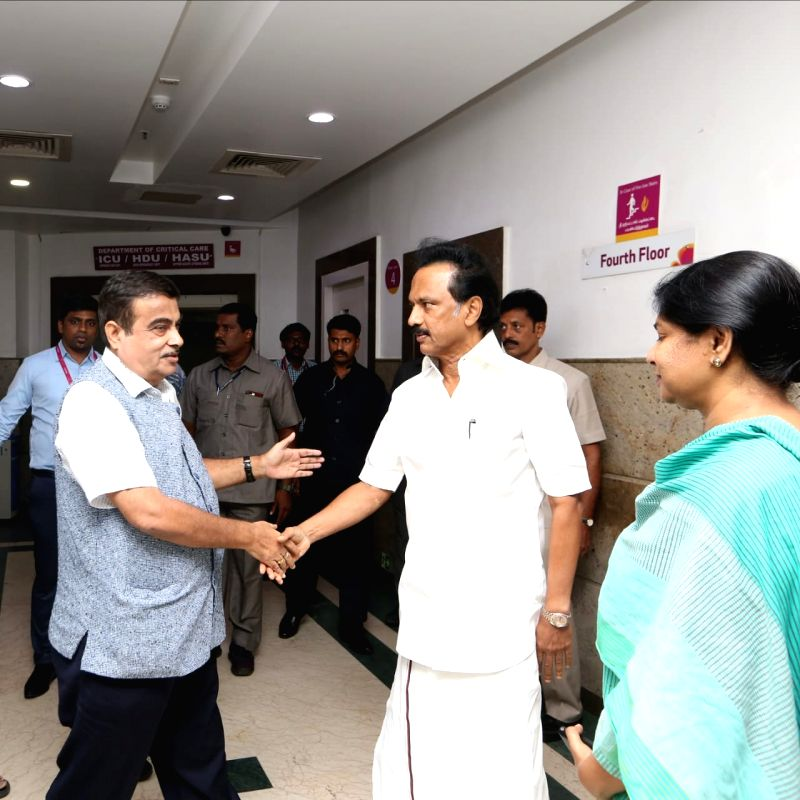 Union Transport Minister and BJP leader Nitin Gadkari with DMK leaders M.K. Stalin and Kanimozhi at Kauvery Hospital where DMK President M. Karunanidhi is admitted, in Chennai on Aug 6, ...