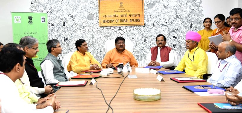 Union Tribal Affairs Minister Jual Oram presides over the signing of an MoU between Tribal Cooperative Marketing Development Federation of India (TRIFED) and National Medicinal Plant Board ... - Jual Oram