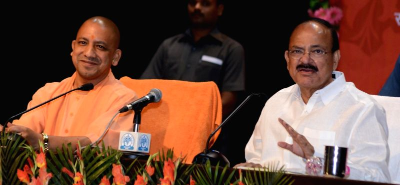 Union Urban Development Minister M Venkaiah Naidu and Uttar Pradesh Chief Minister Yogi Adityanath addresses a press conference in Lucknow, on May 5, 2017. - M Venkaiah Naidu