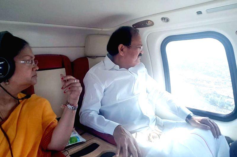 Union Urban Development Minister M. Venkaiah Naidu along with Rajasthan Chief Minister Vasundhara Raje Scindia conducts an aerial survey of Jaipur, on May 24, 2017. - M. Venkaiah Naidu