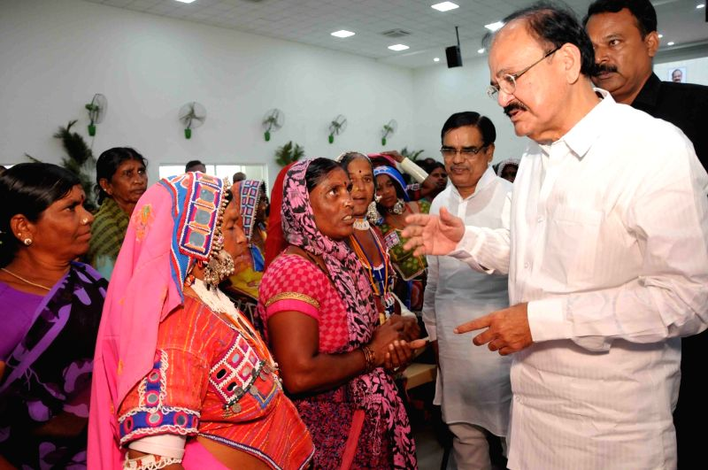 Union Urban Development Minister Venkaiah Naidu  interacts with the Banjara Tribal women at the inauguration of a free medical camp, organised by the Swarna Bharat Trust, in Hyderabad on ... - Venkaiah Naidu