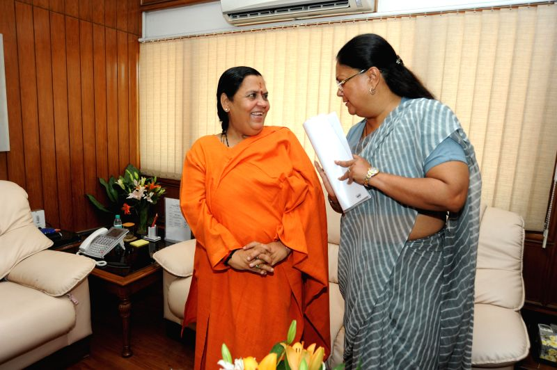 Union Water Resources Minister Uma Bharti during a meeting with Rajasthan Chief Minister Vasundhara Raje in New Delhi on July 2, 2014.