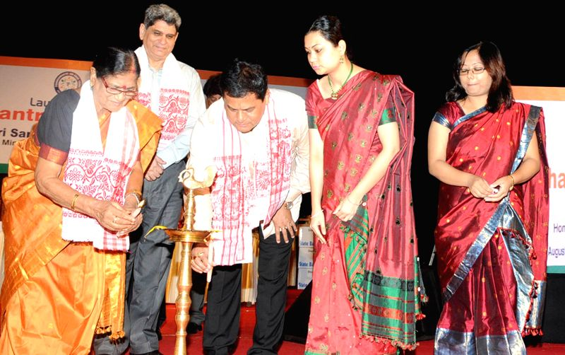 Union Youth Affairs and Sports Minister Sarbananda Sonowal at the inaugural function of Prime Minister Jan-Dhan Abhiyan in Guwahati on Aug 28, 2014. - Sarbananda Sonowal