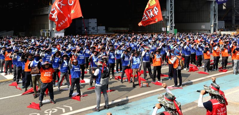 Unionized workers of Hyundai Heavy Industries Co., the country's leading shipbuilder, attend a ceremony at the company's shipyard in the southeastern city of Ulsan on July 19, 2019, to launch ...