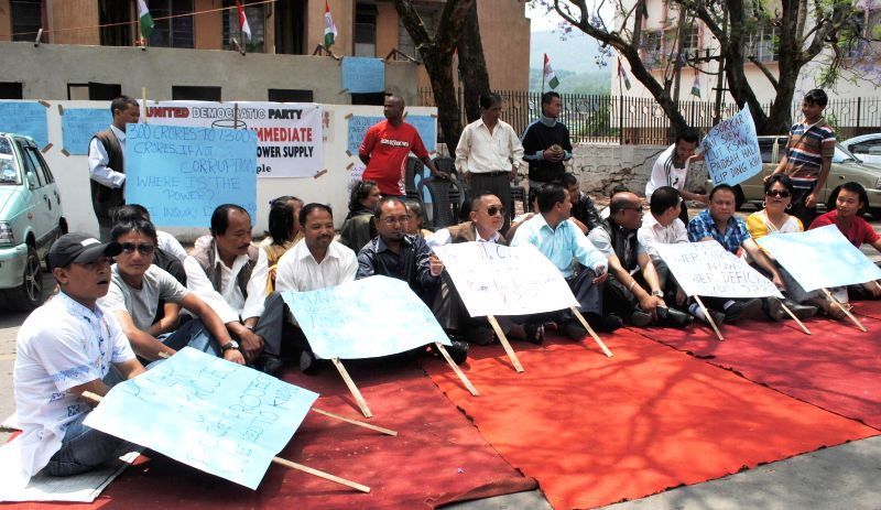 United Democratic Party (UDP) legislators, district council members and senior members stage a sit-in demonstration to protest against the frequent power cuts in Shillong on April 29, 2014.