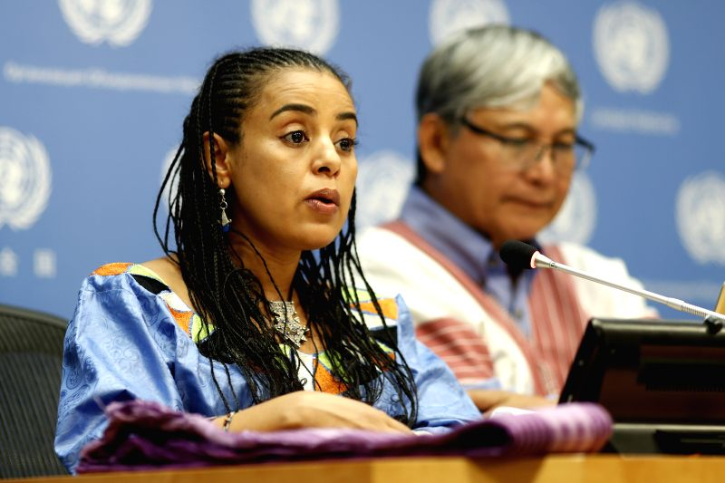 UNITED NATIONS, Aug. 10, 2018 - Mariam Wallet Aboubakrine (L), chairperson of the UN Permanent Forum on Indigenous Issues, speaks during a press conference on the International Day of the World's ...