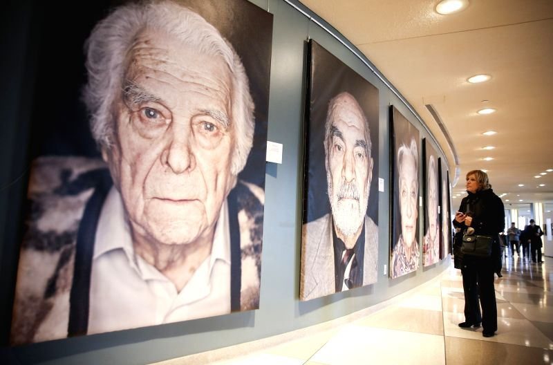 """UNITED NATIONS, Jan. 31, 2018 - A visitor looks at the exhibition """"Survivors, Victims and Perpetrators"""" at the UN headquarters in New York, on Jan. 31, 2018. United Nations ..."""