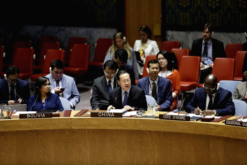 UNITED NATIONS, July 11, 2018 - China's Permanent Representative to the United Nations Ma Zhaoxu (C, Front), addresses a UN Security Council high-level debate on climate-related security risks at the ...