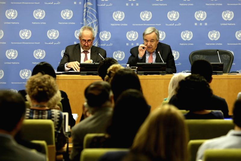 UNITED NATIONS, July 12, 2018 - United Nations Secretary-General Antonio Guterres (R) holds a press conference at the UN headquarters in New York, July 12, 2018. Antonio Guterres on Thursday stressed ...