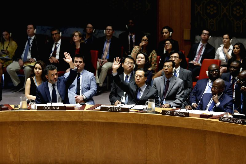 UNITED NATIONS, July 13, 2018 - China's Permanent Representative to the United Nations Ma Zhaoxu (C, Front) votes to abstain on a Security Council resolution to impose an arms embargo on South Sudan ...