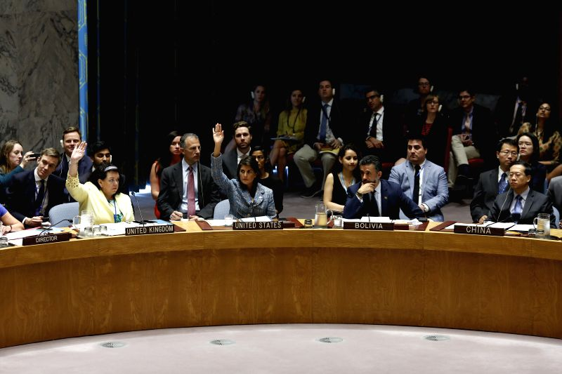 UNITED NATIONS, July 13, 2018 - U.S. Ambassador to the United Nations Nikki Haley (2nd L, Front) and British Ambassador to the United Nations Karen Pierce (1st L, Front) vote in favor of a Security ...