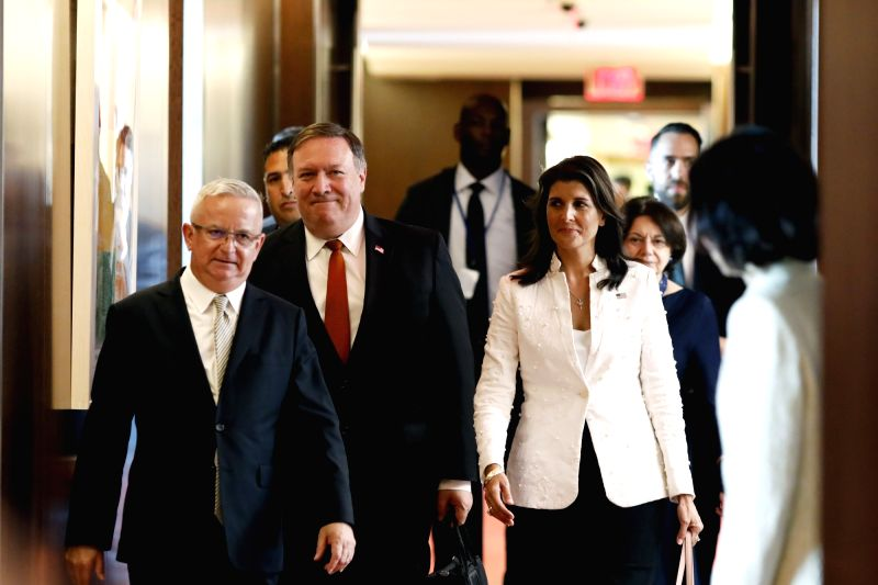 UNITED NATIONS, July 20, 2018 - U.S. Secretary of State Mike Pompeo (L center), accompanied by U.S. Ambassador to the United Nations Nikki Haley (R center), arrives to meet with UN Secretary-General ...