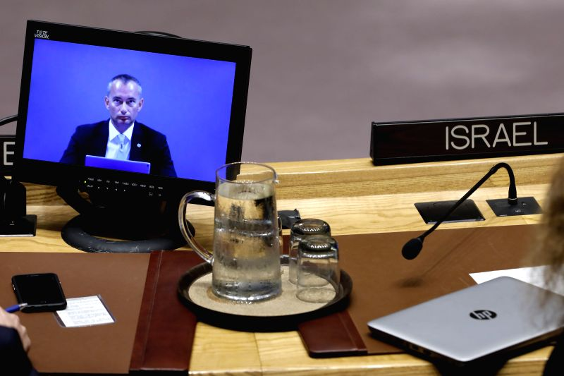 UNITED NATIONS, July 24, 2018 - Nickolay Mladenov (on screen), United Nations Special Coordinator for the Middle East Peace Process, attends a UN Security Council meeting at the UN headquarters in ...
