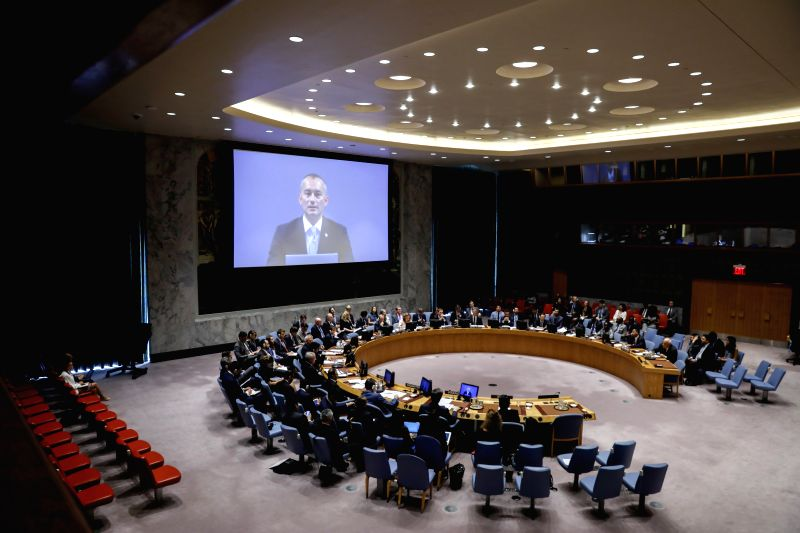 UNITED NATIONS, July 24, 2018 - Nickolay Mladenov (on screen), United Nations Special Coordinator for the Middle East Peace Process, briefs the UN Security Council during a meeting at the UN ...