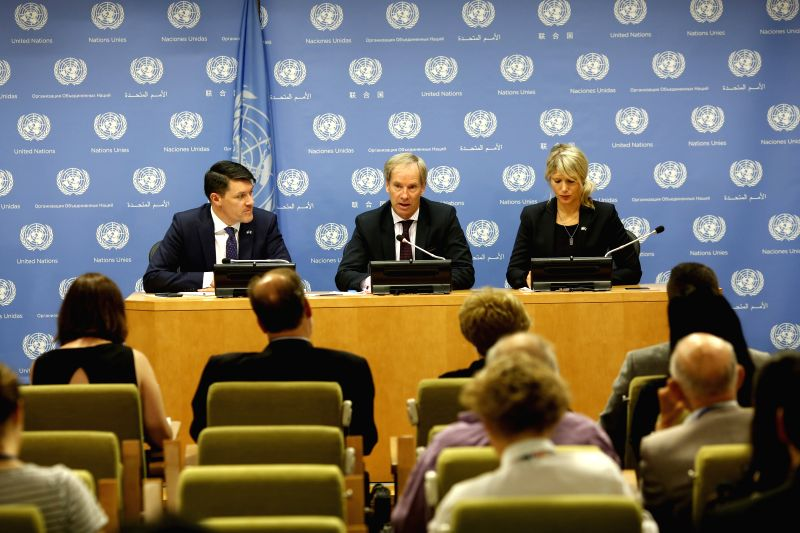 UNITED NATIONS, July 31, 2018 - Swedish Ambassador to the United Nations Olof Skoog (C, back), whose country is winding up its presidency of the Security Council, speaks at a media briefing at the UN ... - Abiy Ahmed