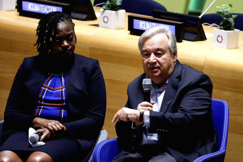 UNITED NATIONS, Sept. 21, 2019 (Xinhua) -- United Nations Secretary-General Antonio Guterres (R) speaks during the UN Youth Climate Summit at the UN headquarters in New York, Sept. 21, 2019. UN Secretary-General Antonio Guterres on Saturday said he s