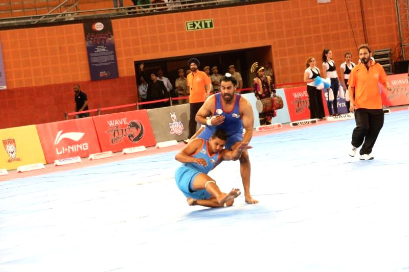 United Singhs player Harjeet Singh and California Eagles Amandeep Johal in action during 9th match of the World Kabaddi League 2014 in New Delhi on Aug 23, 2014. - Harjeet Singh