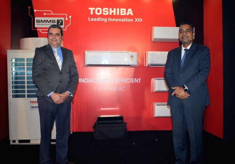 United Technologies -Climate, Controls and Security (UTC) India MD Arun Bhatia, UTC India Marketing Director (Marketing and Strategy) Farokh Madan at the launch of Toshiba Air ...