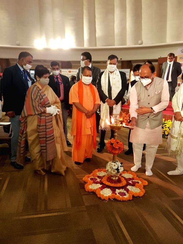 UP CM YOGI ADITYANATH rings the traditional bell to mark the listing ceremony of the Rs.200;cr bonds of Lucknow Municipal Corporation, at the BSE Auditorium