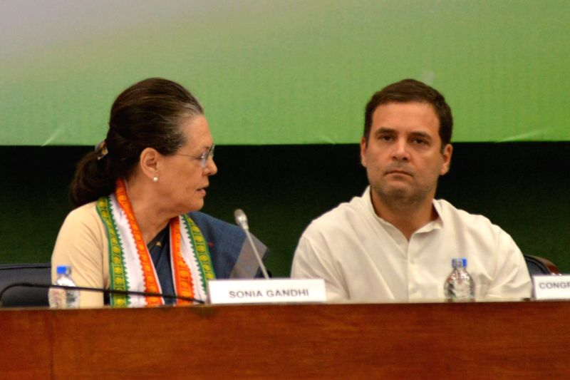 UPA chairperson Sonia Gandhi with her son and Congress President Rahul Gandhi during the extended Congress Working Committee (CWC) meeting, in New Delhi on July 22, 2018. - Sonia Gandhi and Rahul Gandhi
