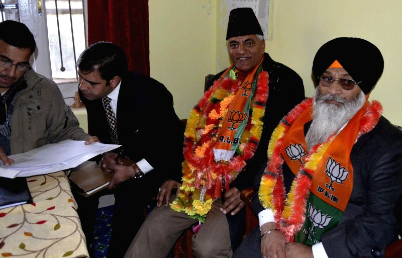 BJP candidate from Uri constituency Mushtaq Ahmad Mir files his nomination papers for upcoming Jammu and Kashmir Assembly polls at Ro office in Uri, Baramulla district on Nov. 20, 2014.