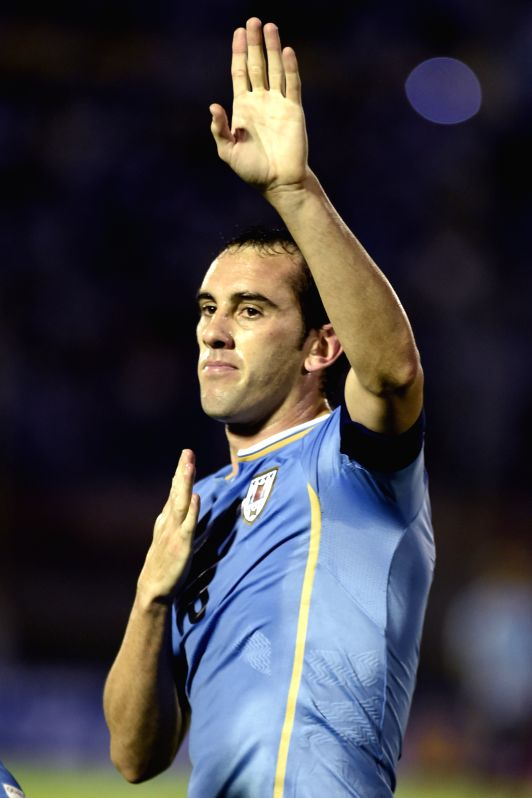 Uruguay's Diego Godin celebrates after scoring during a 2018 Russia World Cup qualifying match against Chile in Montevideo, Uruguay, Nov. 17, 2015. Uruguay won ...