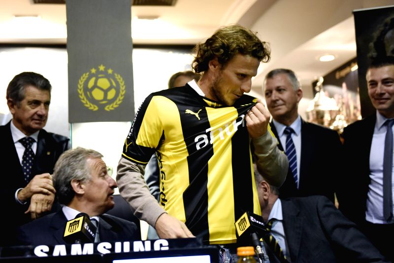Uruguayan football player Diego Forlan reacts during his presentation as new player of Club Atletico Penarol, in Montevideo, Uruguay, on July 10, 2015. ...