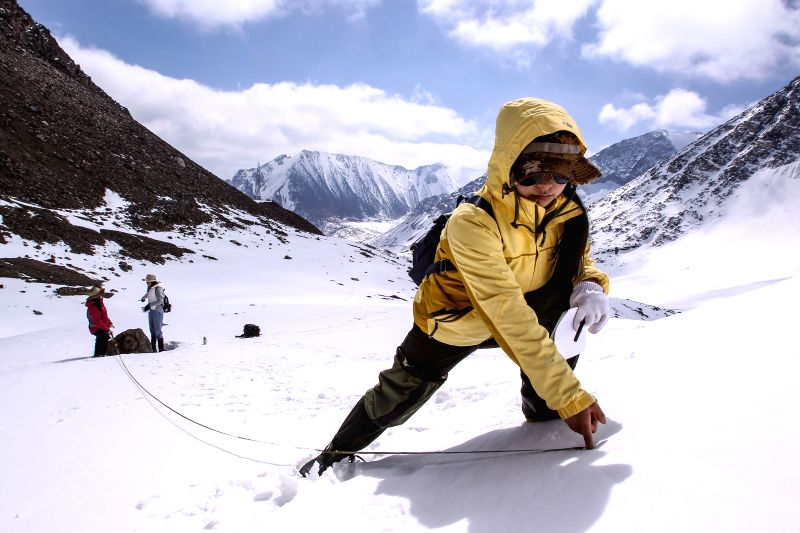 URUMQI, April 30, 2017 - A scientist from Northwest Institute of Eco-Environment and Resources, China Academy of Sciences (CAS), examines the glacial retreat at Urumqi River source Glacier No.1 in ...