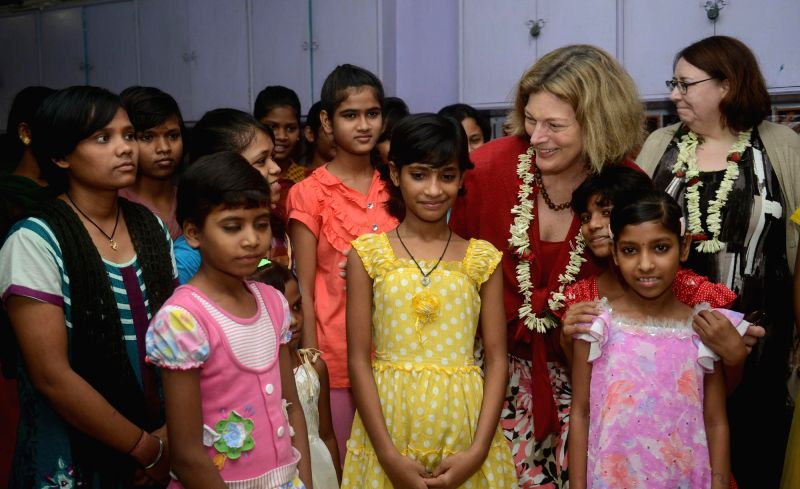 US Ambassador to India Kathleen Stephens with children during her visit to CINI (Child in Need Institute) - children's short stay home, in Kolkata on Aug 13, 2014.