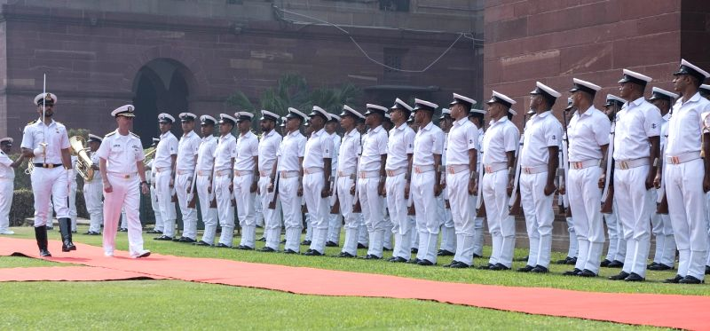 US Navy chief Admiral John Richardson inspects a guard of honour in New Delhi on Monday, May 13. (Photo: US Navy/IANS)