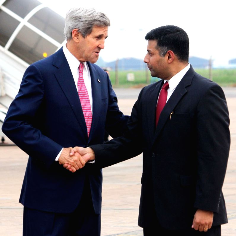US Secretary of State John Kerry being greeted by Indian Joint Secretary (Americas) Vikram Kumar Doraiswami as the former's arrival at Air Force Station, Palam in New Delhi on July 30, 2014. - Vikram Kumar Doraiswami