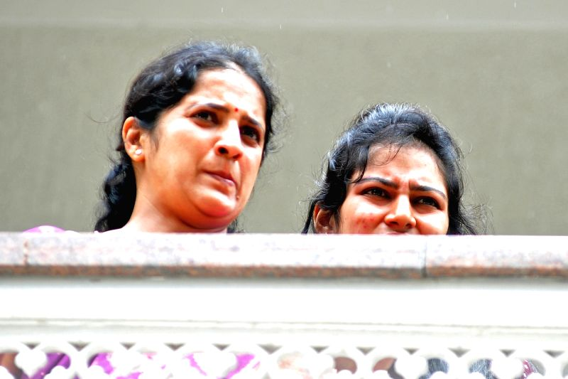 Usha Shivakumar, wife of Karnataka Power Minister D.K. Shivakumar at her residence during the Income Tax department raids in Bengaluru on Aug 4, 2017. - D.
