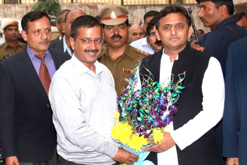 Uttar Pradesh Chief Minister Akhilesh Yadav with Delhi Chief Minister Arvind Kejriwal in New Delhi, on Dec 10, 2015. - Akhilesh Yadav and Arvind Kejriwal
