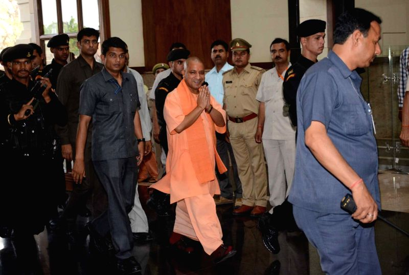 Uttar Pradesh Chief Minister Yogi Adityanath arrives to attend a cabinet meeting in Lucknow on April 18, 2017. - Yogi Adityanath