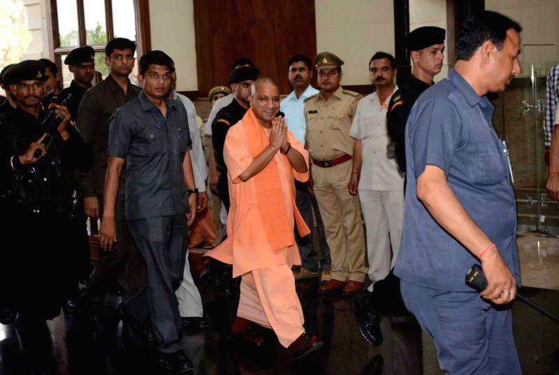 Uttar Pradesh Chief Minister Yogi Adityanath arrives to attend a cabinet meeting in Lucknow on April 18, 2017. - Yogi Adityanath
