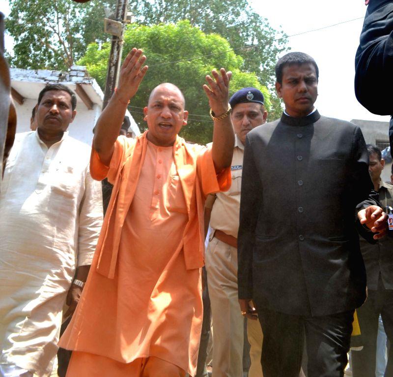 Uttar Pradesh Chief Minister Yogi Adityanath during his visit to a slum in Agra on May 7, 2017. - Yogi Adityanath