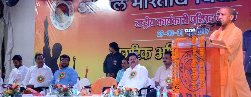Uttar Pradesh Chief Minister Yogi Adityanath addresses during an ABVP programme in Lucknow on May 28, 2017. - Yogi Adityanath