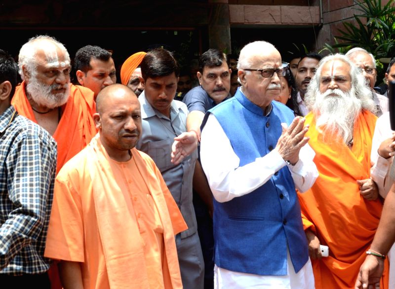 Uttar Pradesh Chief Minister Yogi Adityanath welcomes BJP veteran LK Advani at a Lucknow guest house on May 30, 2017. - Yogi Adityanath