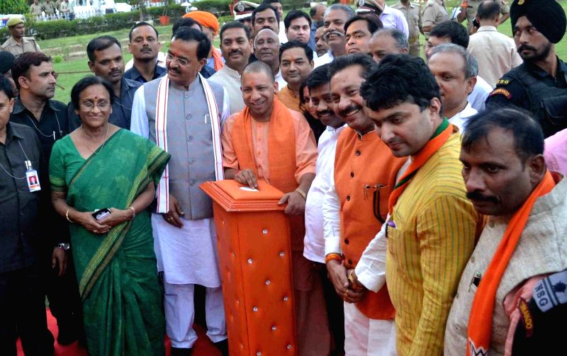 Uttar Pradesh Chief Minister Yogi Adityanath unveils statue of Chandra Shekhar Azad in Allahabad on June 3, 2017. - Yogi Adityanath
