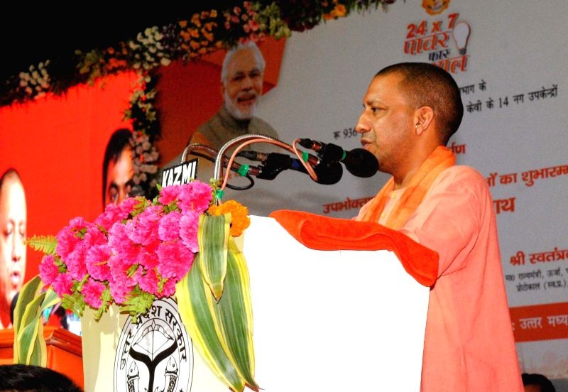 Uttar Pradesh Chief Minister Yogi Adityanath addresses during a programme organised to inaugurate North Central Zone Cultural Centre (NCZCC) in Allahabad, on June 4, 2017. - Yogi Adityanath