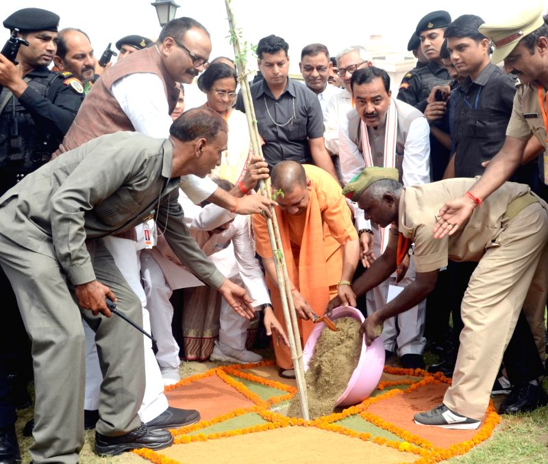 Uttar Pradesh Chief Minister Yogi Adityanath plants a sapling on World Environment Day in Lucknow on June 5, 2017. - Yogi Adityanath