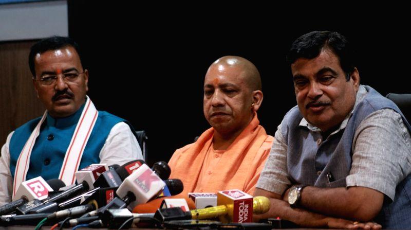 Uttar Pradesh Chief Minister Yogi Adityanath addresses a press conference in New Delhi on June 12, 2017. Also seen Union Transport Minister Nitin Gadkari and Uttar Pradesh Deputy Chief ... - Yogi Adityanath