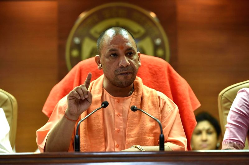Uttar Pradesh Chief Minister Yogi Adityanath addresses a press conference in Lucknow on Aug 12, 2017. - Yogi Adityanath