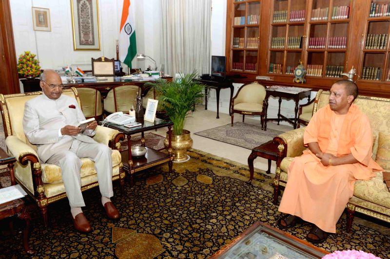 Uttar Pradesh Chief Minister Yogi Adityanath calls on President Ram Nath Kovind at Rashtrapati Bhavan, in New Delhi, on July 12, 2018. - Yogi Adityanath and Nath Kovind